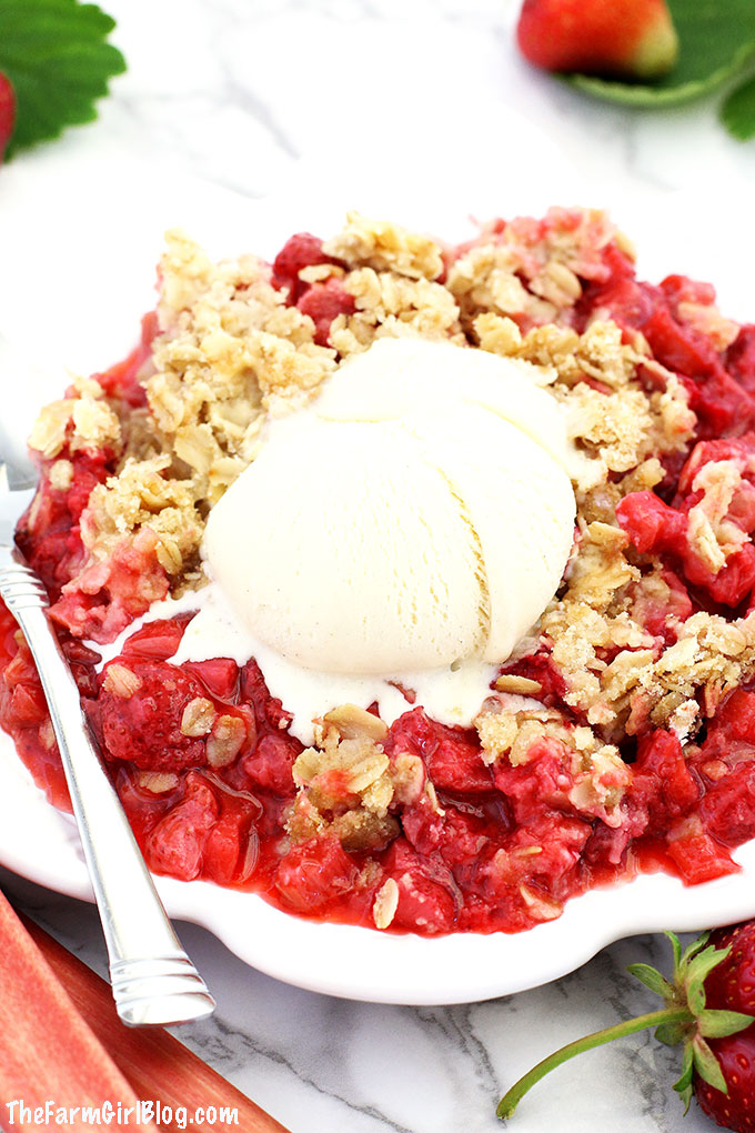 This Easy Strawberry Rhubarb Crisp Recipe is much easier to make and healthier than a pie. The crisp is loaded with homegrown strawberries and rhubarb. It is topped with delicious lightly sweetened brown sugar oats crumble. It's hard to resist from this crisp made with homegrown fruit, which makes this recipe special and super tasty.