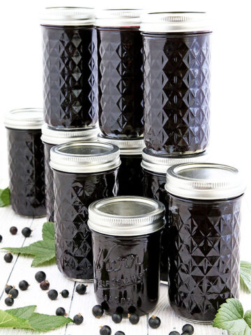 Have you ever tried blackcurrant jam? It's one of my favorite jams. Canned Blackcurrant Jam Recipe is much easier to make than you can imagine. I have several blackcurrant bushes in my garden. The jam comes into production fairly quickly, if you don't count the harvest time. And with as many kiddo helpers that I have, we tackled one bush in just a few hours and produce 11 pounds of harvest. #blackcurrantjam #homegrownblackcurrant #easyrecipe #gardengrownblackcurrant