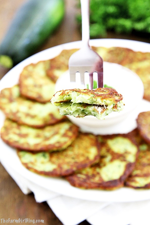 These Zucchini Pancakes are a wonderful way to enjoy the abundance of your garden-fresh zucchinis. They are golden and crisp on the outside and soft and moist on the inside. The addition of fresh homegrown garlic adds a savory, robust kick. There's so much flavor in these pancakes, you just can't stop enjoying them. #zucchinipancakes #homegrownzucchini #organicgarlic #organiczucchini #thefarmgirlblog