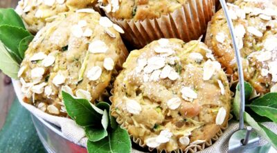 This Apple Zucchini Muffins Recipe is a must-make Fall treat! They are tender, fluffy, airy and loaded with homegrown zucchini and chunks of homegrown apples. I love this recipe because it has no added oil moistener in it, but are only moistened by apple sauce. This adds a rich and delicious taste as well as making them super moist. #applezucchinimuffins #cleaneating #homegrownproduce #thefarmgirlblog
