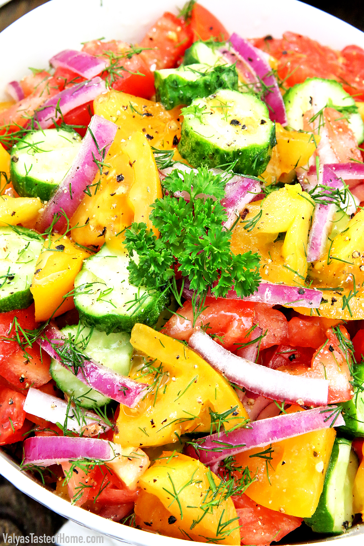 This Simple and Fresh Cucumber Tomato Garden Salad is amazingly refreshing and scrumptious! It's usually not summer for us if we haven't enjoyed this salad made from fresh, organically homegrown, crispy garden veggies.