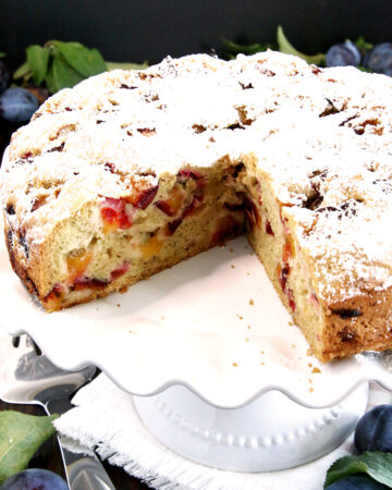 Plums are amazing for baking! They have just the right amount of tartness that balances perfectly with the sweet sponge cake. This Simple Gluten-Free Plum Coffee Cake recipe is moist, fluffy, and loaded with juicy homegrown Damson plums. It is very easy to make but is absolutely delicious.